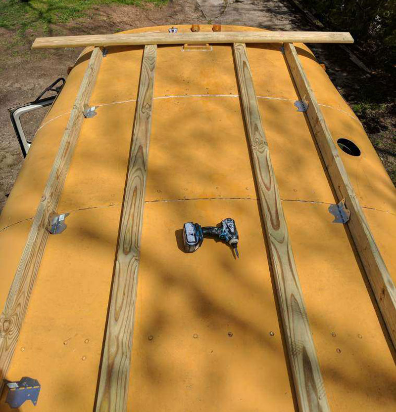 School bus rv rooftop deck construction for Rv with roof deck